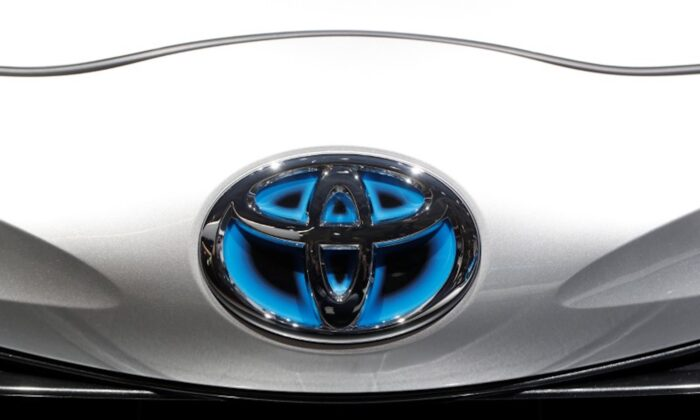 The Toyota logo is seen during the first press day of the Paris auto show, in Paris, France, on Oct. 2, 2018. (Reuters/Benoit Tessier)