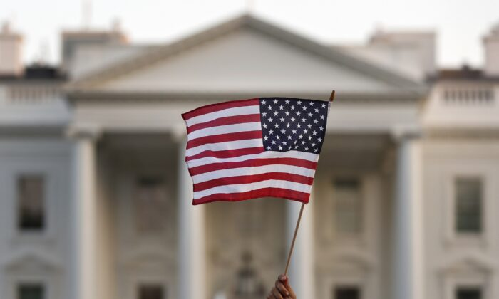 A flag is waved outside the White House in Washington in a 2017 file photo. (Carolyn Kaster/AP Photo)