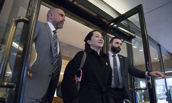 Meng Wanzhou, chief financial officer of Huawei, leaves B.C. Supreme Court in Vancouver on Jan. 21, 2020. Vancouver actor Julia Hackstaff says she was conned into protesting outside the courthouse while Meng's extradition hearing was underway. (The Canadian Press/Jonathan Hayward)