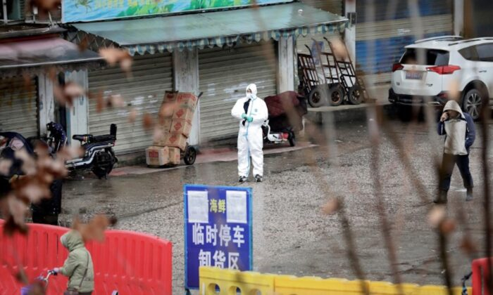 A worker in a protective suit is seen at the closed seafood market in Wuhan, Hubei Province, China on Jan. 10, 2020. (Reuters)