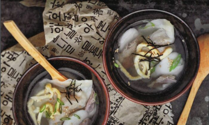 Korean rice cake soup with dumplings, traditionally eaten to celebrate Lunar New Year. (Jean Cazals)