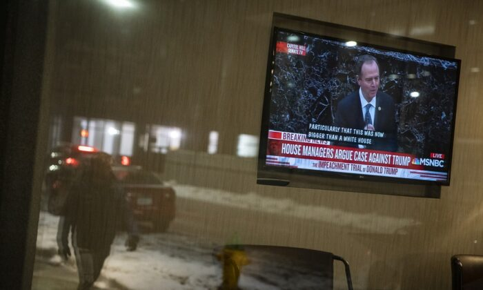 A television screen shows House impeachment manager Rep. Adam Schiff (D-Calif.) during the Senate impeachment trial of U.S. President Donald Trump, at a hotel in Des Moines, Iowa, on Jan. 22, 2020. (Al Drago/Getty Images)