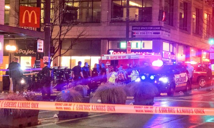 Police work the scene of a shooting on Third Avenue and Pine Street on Jan. 22, 2020, in Seattle. (Amanda Snyder/The Seattle Times via AP)