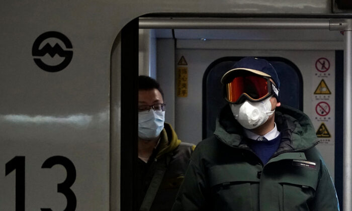 People wearing masks are seen on a subway in Shanghai, China, on Jan. 23, 2020. (Aly Song/Reuters)