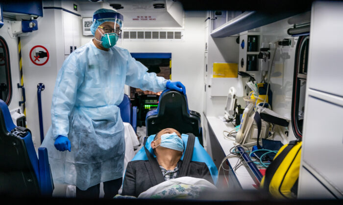 A patient is transferred by an ambulance to the Infectious Disease Centre of Princess Margaret Hospital in Hong Kong on Jan. 22, 2020. (Anthony Kwan/Getty Images)