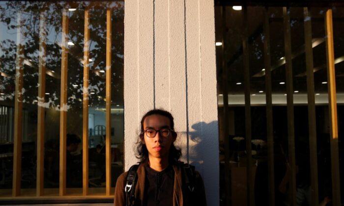 Derek Tai poses for photo at the campus of Chinese University of Hong Kong in Hong Kong, China, on Jan. 14, 2020. (Tyrone Siu/Reuters)