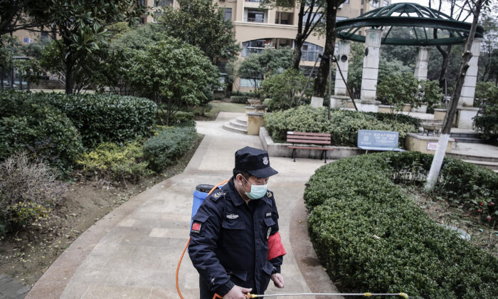 A security guard sprays alcohol to disinfect areas in Wuhan City, Hubei Province, China on Jan. 23, 2020. (Getty Images)