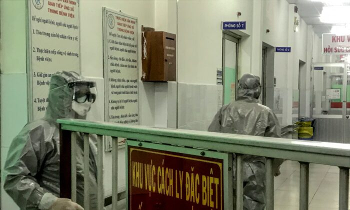Medical workers enter an isolation area to visit the first two cases of the new coronavirus infection, in Cho Ray hospital in Ho Chi Minh City on Jan. 23, 2020. (Bach Duong/AFP via Getty Images)