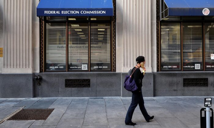 A pedestrian walks past the Federal Election Commission's headquarters in Washington on Oct. 24, 2016.  Chip Somodevilla/Getty Images