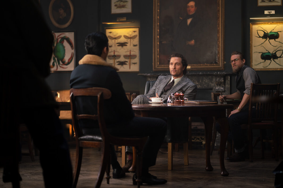 3 men sit at a table