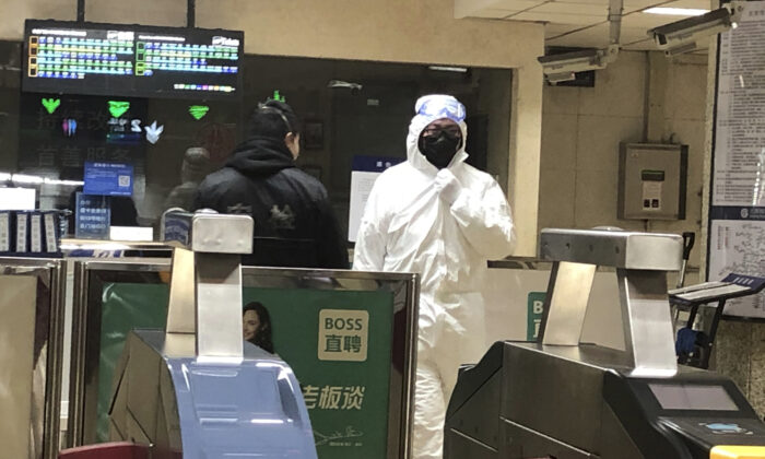 A security officer wears a hazardous materials suit at a subway station in Beijing, China amid the Wuhan coronavirus outbreak on Jan. 24, 2020. (Yunan Wang/AP Photo)