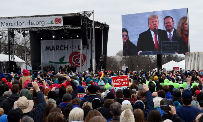 "Pro-life demonstrators listen to President Donald Trump as he speaks at the 47th annual ""March for Life"" in Washington on Jan. 24, 2020. (Olivier Douliery/AFP via Getty Images)"