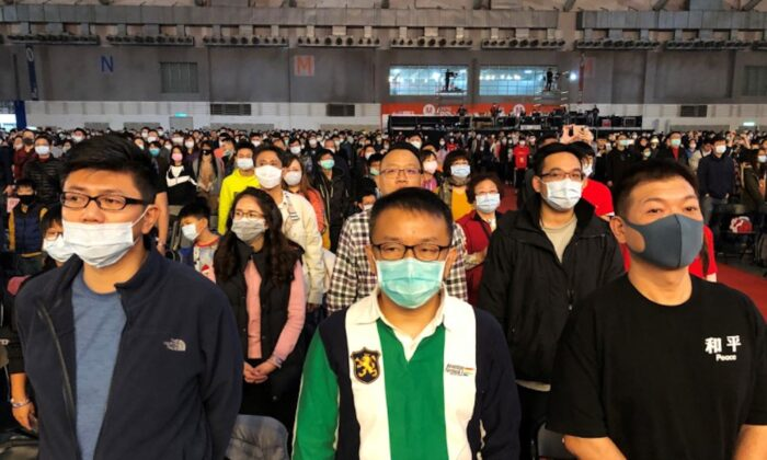 Foxconn employees wearing masks attend the company's year-end gala in Taipei, Taiwan on Jan. 22, 2020. (Yimou Lee/Reuters)