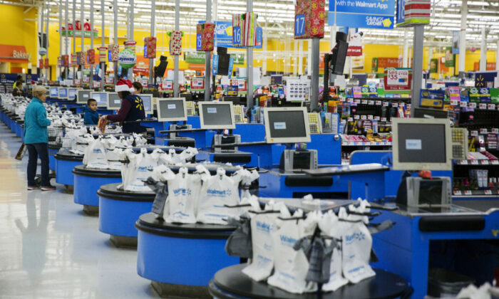 Employees work at the checkout counters of a Walmart store in Secaucus, N.J., on Nov. 11, 2015. (Lucas Jackson/Reuters)