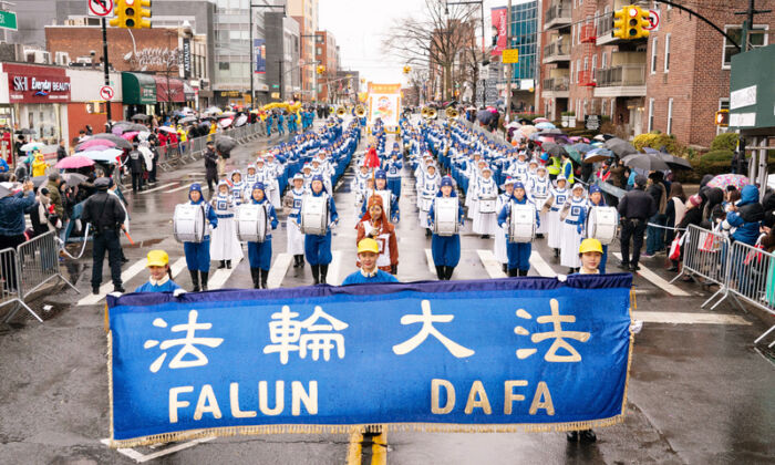 Tianguo Marching Band of Falun Gong group is performing at the Chinese New Year parade in Flushing, New York on Jan. 25, 2020. (Dai Bing/The Epoch Times)