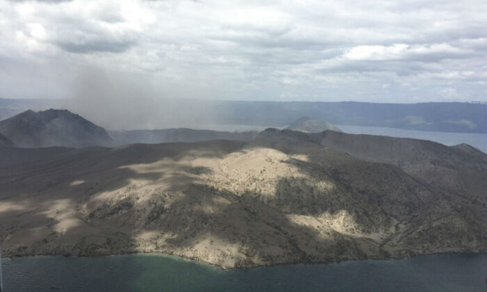 Taal volcano emits small amounts of ash in Batangas province, southern Philippines, on Jan. 21, 2020. (Philippines Office of Civil Defense via AP)