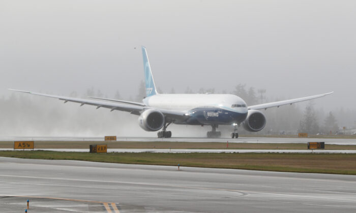 A Boeing 777X airplane takes off during its first test flight from the company's plant in Everett, Washington, on Jan. 25, 2020. (Terray Sylvester/Reuters)