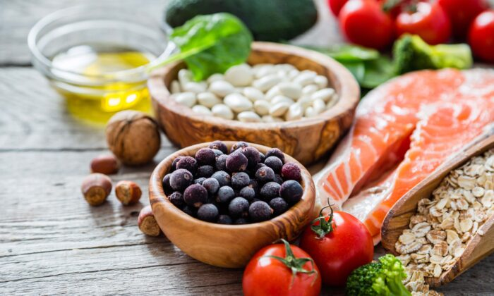 Berries, fatty fish, and walnuts are all excellent foods for brain health. (Oleksandra Naumenko/Shutterstock)
