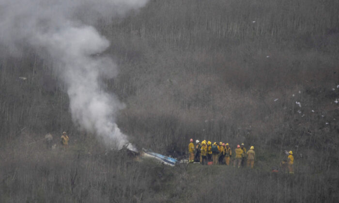 LA county firefighters on the scene of a helicopter crash that reportedly killed Kobe Bryant in Calabasas, Calif., on Jan. 26, 2020. (Gene Blevins/Reuters)