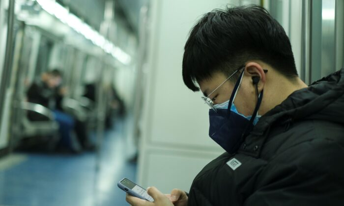 A man wearing two face masks travels in the subway, as China is hit by an outbreak of the new coronavirus, in Beijing, on Jan. 26, 2020.  (Reuters/Carlos Garcia Rawlins)