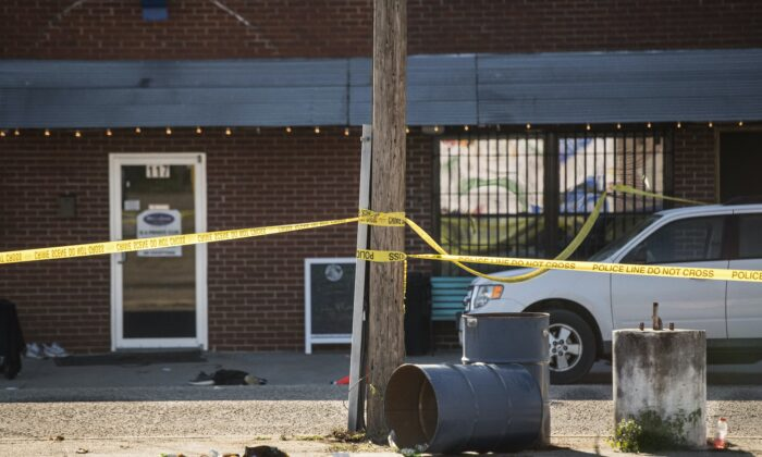 Crime scene tape stretches in front of Mac's Lounge, the scene of an early morning bar shooting, , in Hartsville, S.C., on Jan. 26, 2020. (Sean Rayford/AP Photo)