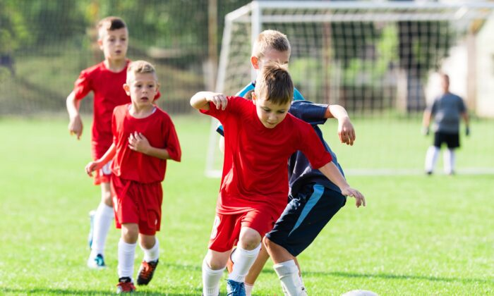Kids burn off an average of 170 calories playing team sports but consume an average of 213 from sugary drinks and snacks handed out by parents after the game. (Fotokostic/Shutterstock)