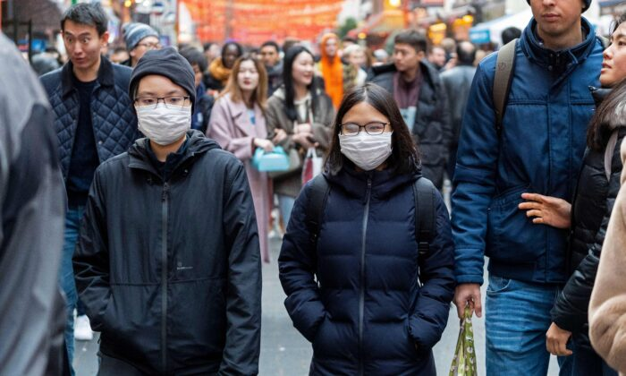 Pedestrians are seen wearing surgical masks in London's Chinatown on Jan. 25, 2020. (Niklas Halle'n/AFP via Getty Images)