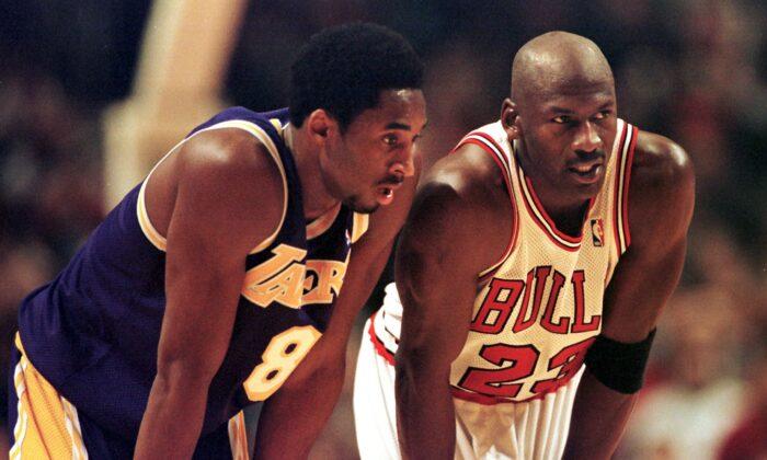 Michael Jordan and Kobe Bryant  in a file photo. (Vincent Laforet / AFP)