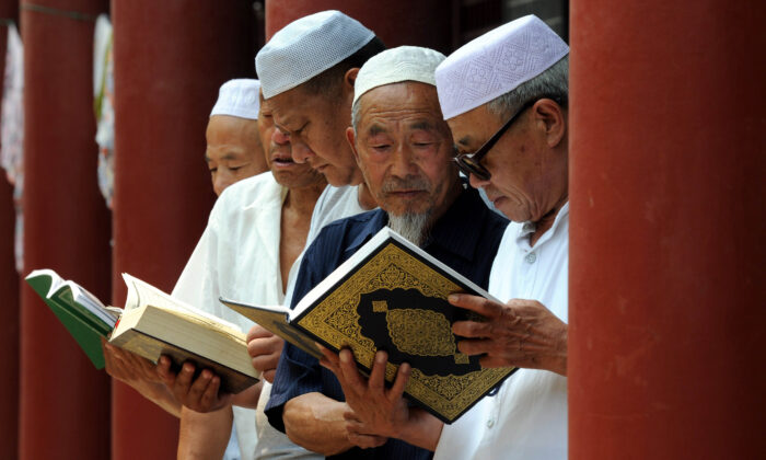Chinese Muslims read the Koran at a mosque in Tancheng, in eastern China's Shandong Province, at the beginning of the holy month of Ramadan, on June 30, 2014.  -/AFP via Getty Images)