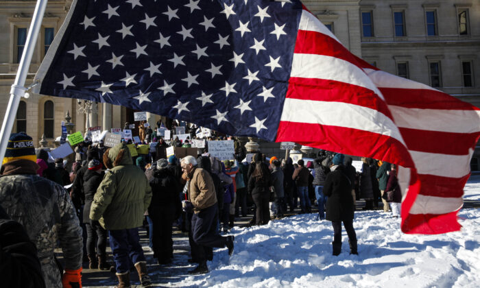 Protestor rally at the Michigan State Capitol before the state electoral college met to cast their votes in Lansing, Mich., on Dec. 19, 2016.  Sarah Rice/Getty Images