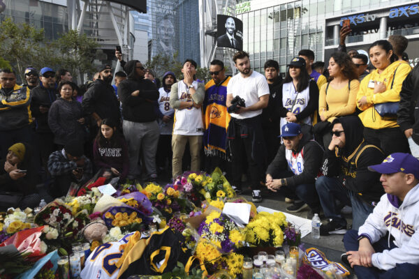 People gather at a memorial for Kobe Bryant