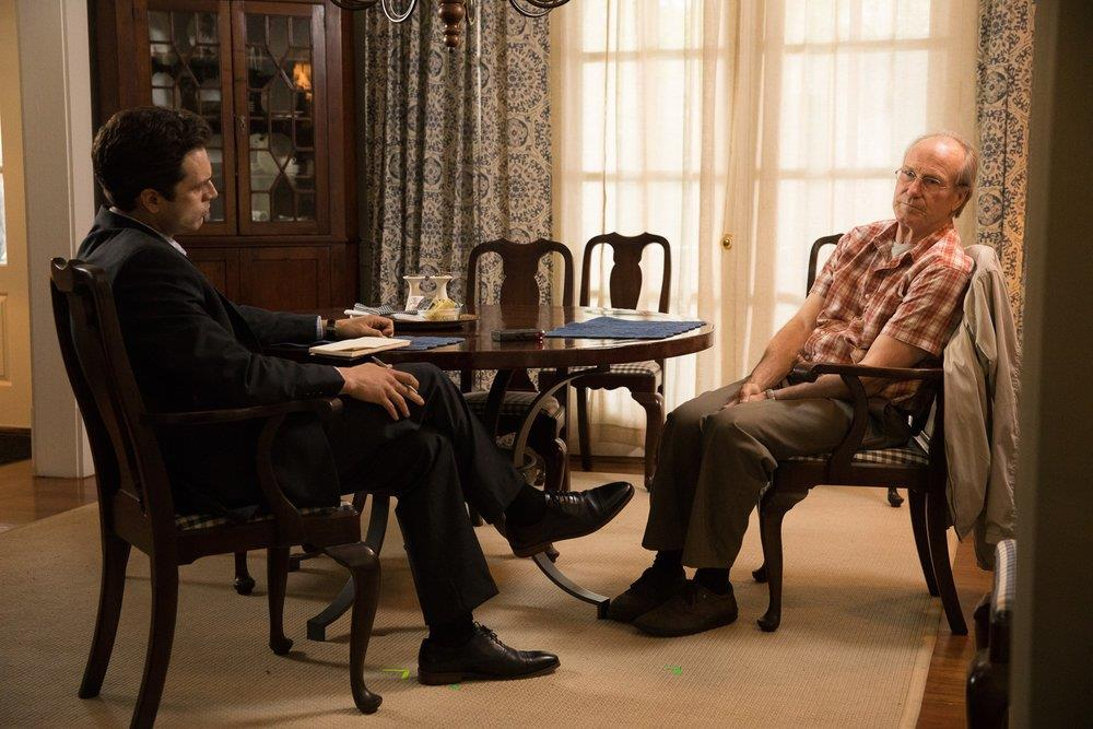 two men talking at table