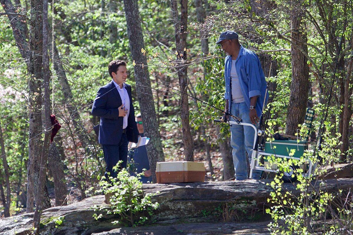 Two men talking in woods