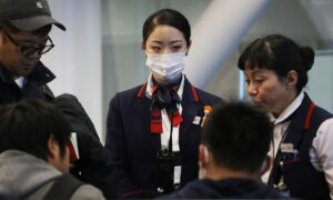 US Considers Expanding Screening of Airline Passengers for New Virus From China