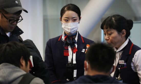 US Considering Expanding Screening of Airline Passengers for New Virus From China