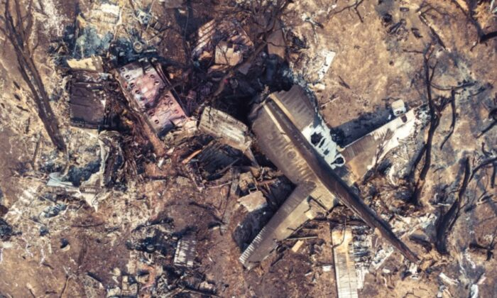 Debris seen following the crash of a C-130 air tanker plane after dropping fire retardant, in snowy Mountains, New Mountains, New South Wales, Australia, on Jan. 24, 2020. (New South Wales Police/ via Reuters)