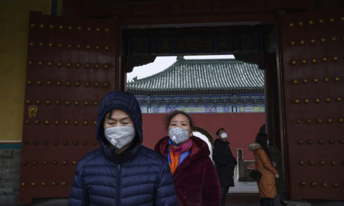 Visitors wear protective masks as they tour the Temple of Heaven in Beijing, China amid the coronavirus outbreak on Jan. 27, 2020. (Kevin Frayer/Getty Images)
