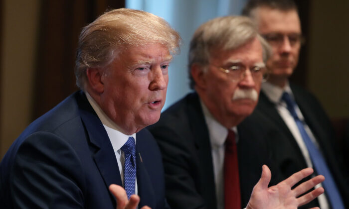 President Donald Trump is flanked by National Security Adviser John Bolton in the Cabinet Room of the White House in Washington on April 9, 2018. (Mark Wilson/Getty Images)