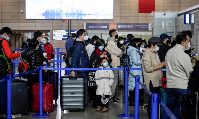 Passengers wearing masks are seen at the Pudong International Airport in Shanghai, China, on Jan. 27, 2020. (Aly Song/Reuters)