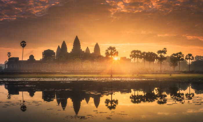 The temples within Angkor Archeological Park were built from the 9th to the 13th century. Sunrise is a popular time to catch Angkor Wat's reflection. (Shutterstock)