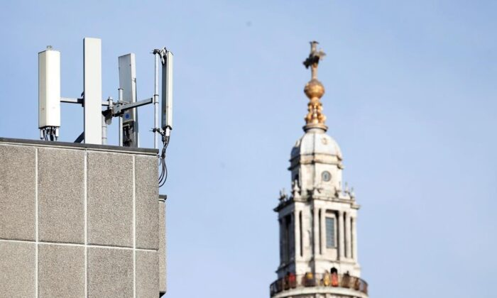Mobile network phone masts are visible in front of St Paul's Cathedral in London, England on Jan. 28, 2020. (AP Photo/Alastair Grant)