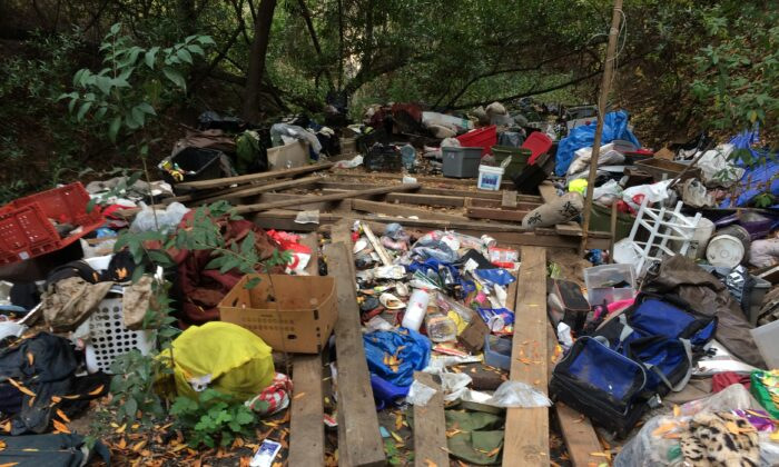 Waste from a homeless encampment along San Lorenzo Creek in Castro Valley, Calif. Local residents are paying the bill to clean it up after authorities cleared out the camp's inhabitants. (Courtesy of Alameda County)