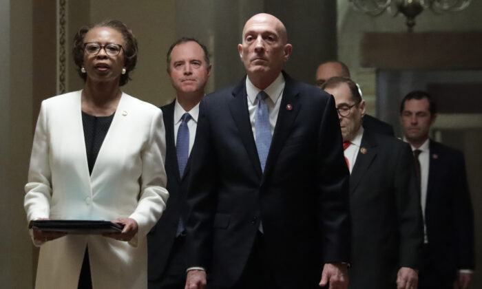 U.S. House Sergeant at Arms Paul Irving and House Clerk Cheryl Johnson, as they lead the seven impeachment managers, including House Intelligence Committee Chairman Rep. Adam Schiff (D-Calif.), House Judiciary Committee Chairman Rep. Jerry Nadler (D-N.Y.), and Rep. Jason Crow (D-Colo.), bring the two impeachment articles to the Senate chamber of the U.S. Capitol in Washington on Jan. 15. 2020. (Alex Wong/Getty Images)