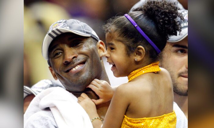 Kobe Bryant #24 of the Los Angeles Lakers holds his daughter, Gianna, after the Lakers defeated the Orlando Magic 99-86  in Game Five of the 2009 NBA Finals at Amway Arena in Orlando, Fla., on June 14, 2009. (Ronald Martinez/Getty Images)