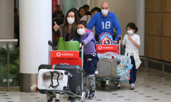 Passengers arrive at Sydney International Airport in Sydney, Australia, on Jan. 23, 2020. (Don Arnold/Getty Images)