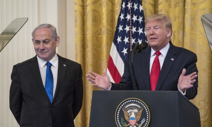 U.S. President Donald Trump and Israeli Prime Minister Benjamin Netanyahu participate in a joint statement in the East Room of the White House on Jan. 28, 2020. (Sarah Silbiger/Getty Images)