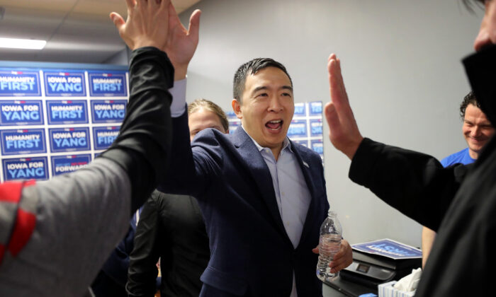 Democratic presidential candidate Andrew Yang gives high-fives to campaign volunteers following a town hall meeting at Penn Central Mall in Oskaloosa, Iowa, on Jan. 25, 2020. (Chip Somodevilla/Getty Images)