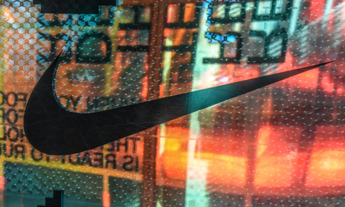 A Nike logo is seen at the Nike flagship store on 5th Ave. in New York City on Dec. 20, 2019. (Stephanie Keith/Getty Images)