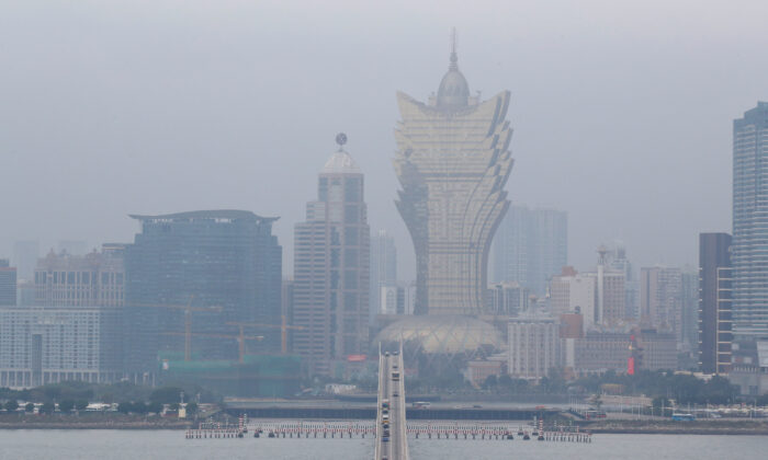 The Grand Lisboa casino and other buildings are seen in Macau, China on Dec. 19, 2019, on the eve of the 20th anniversary of the former Portuguese colony's return to China. (Reuters)