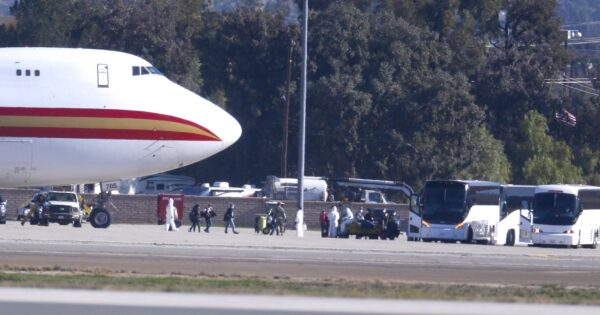 Evacuated Americans get off plane